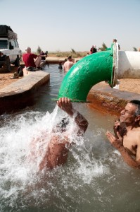Desert travelers bathe in a Saharan hot springs near Farafra Oasis, Western Desert, Egypr