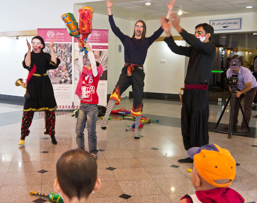 The Rickshaw Circus team performing for kids in Iran.