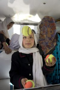A young Afghan girl juggling as part of the Rickshaw Circus.