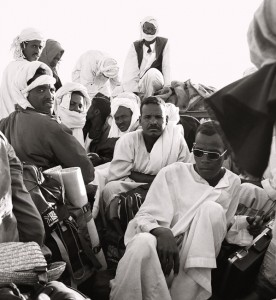 Sudanese villagers atop a lorry heading in the direction of Meroe, Sudan