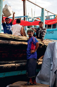 South Asian workers at the dhow wharfage in Dubai, UAE