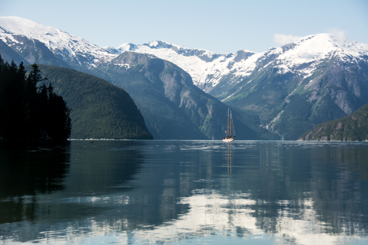 A sailboat in the Great Bear Rainforest region of British Columbia, Canada