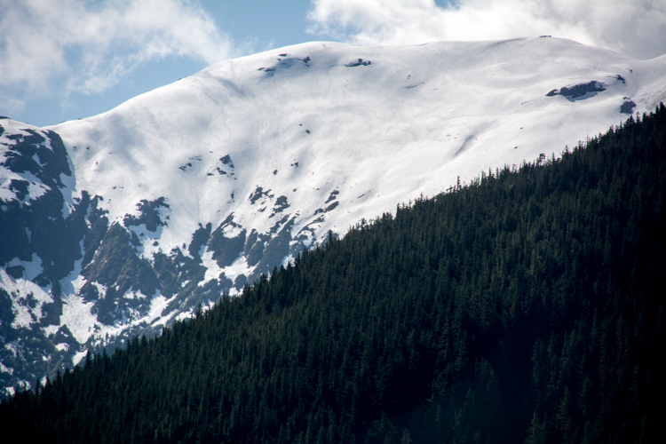 A snow topped mountain in the Great Bear Rainforest region of British Columbia, Canada