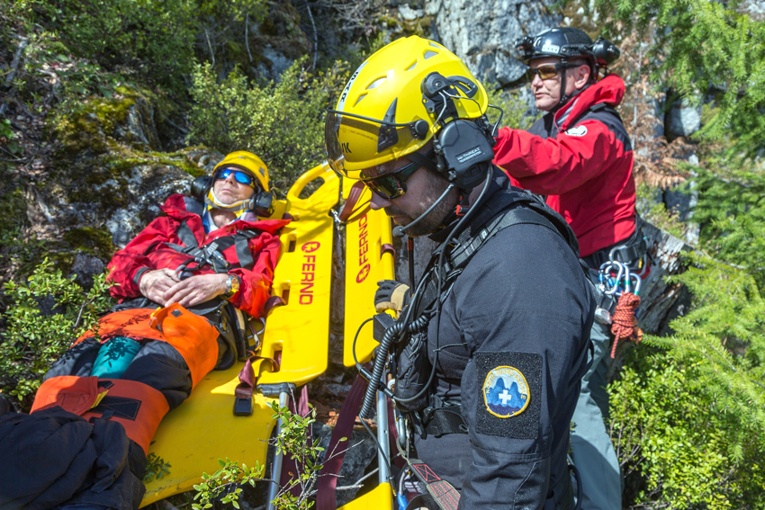 North Shore Rescue assisting an injured hiker, near Vancouver, British Columbia.