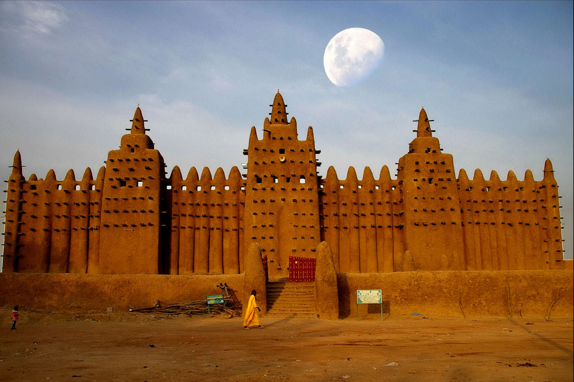 A man walks on the outskirts of the town of Timbuktu.