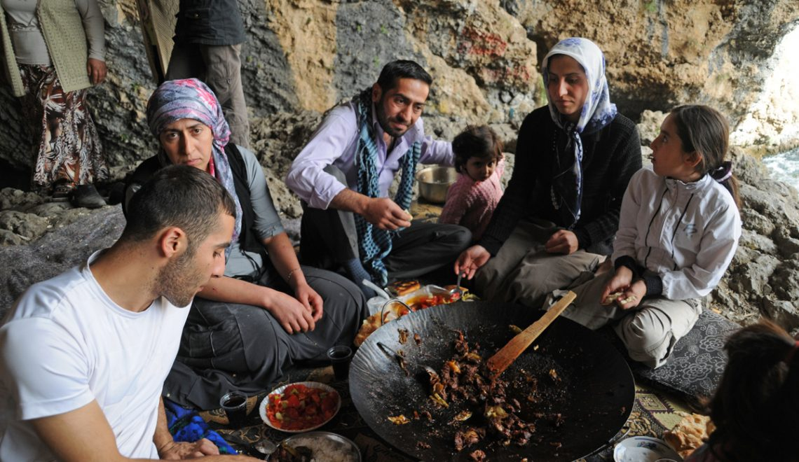A Kurdish family having a meal in Bahcesaray in Eastern Turkey.